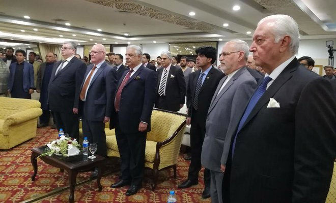 guests stand in honor of the national anthems of russia and pakistan at the inaugural ceremony photo courtesy arab news