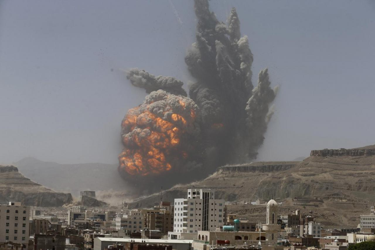smoke rises during an air strike on an army weapons depot on a mountain overlooking sanaa photo reuters