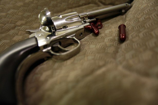 a revolver and dummy bullets are displayed on a case photo reuters