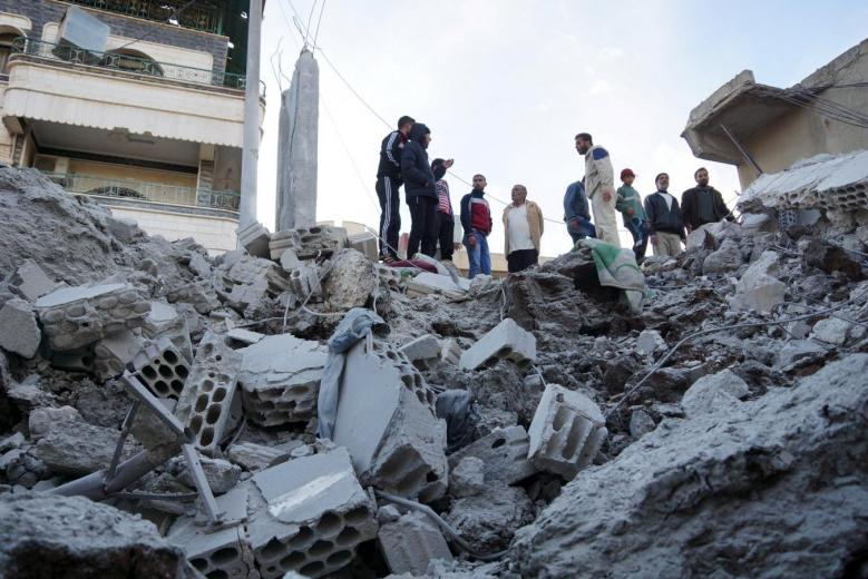 residents inspect a damaged site from what activists said were airstrikes carried out by the russian air force in nawa city deraa syria photo reuters