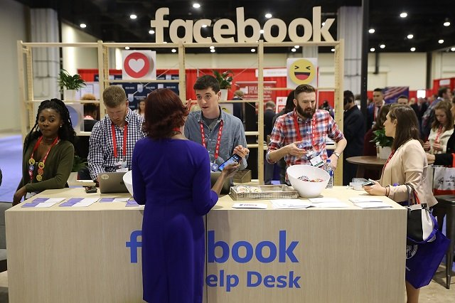 attendees visit the facebook help desk inside the conservative political action conference hub at the gaylord national resort and convention center february 23 2018 in national harbor maryland photo afp