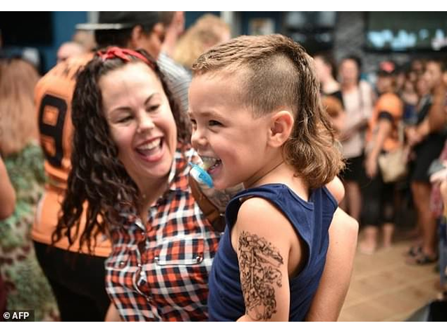 a child sports a mullet haircut at mulletfest 2018 in the town of kurri kurri 150 kms north of sydney on february 24 2018 mulletfest is a celebration of the iconic haircut called the mullet which began in the 1970s and popular in the 1980s and making a comeback in australia photo afp