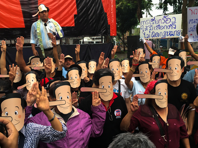 thai activists in pinocchio masks call junta leader liar