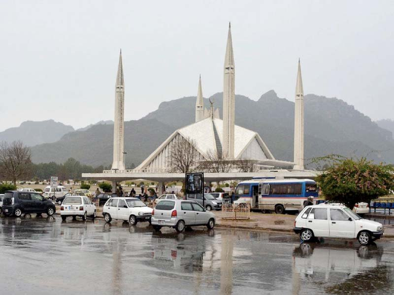 vehicles of picnickers seen parked near faisal mosque photo inp