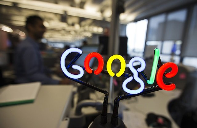 a neon google logo is seen as employees work at the new google office in toronto november 13 2012 photo reuters