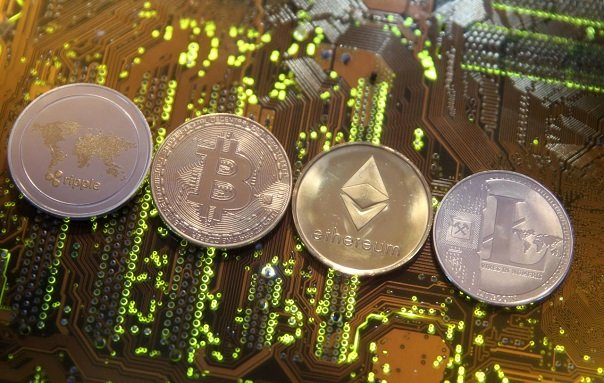 representations of the ripple bitcoin etherum and litecoin virtual currencies are seen on a pc motherboard in this illustration picture february 13 2018 photo reuters