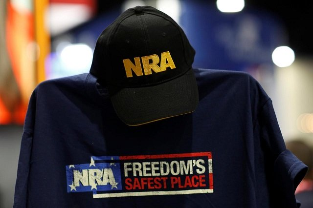 a cap and shirt are displayed at the nra booth at the conservative political action conference at national harbor maryland us february 23 2018 photo reuters