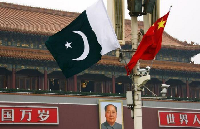 a pakistan national flag flies alongside a chinese national flag in front of the portrait of chairman mao zedong on beijing 039 s tiananmen square photo reuters