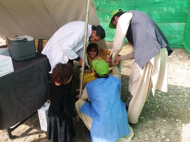 polio drops being administered photo express