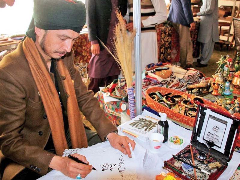 a calligrapher demonstrates skills during cultural caravan seminar held at pnca photo online