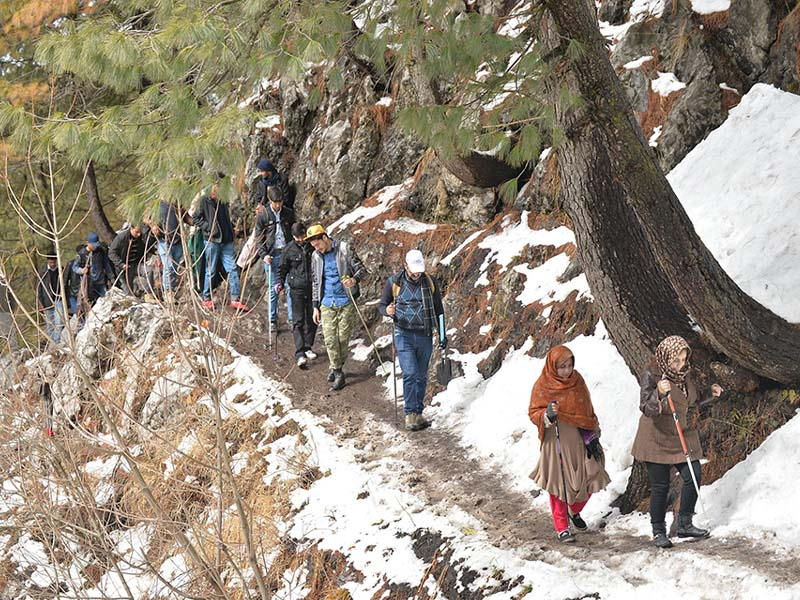 hikers move along a trail in nathiagali photo express