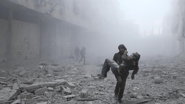 a wounded man is carried following an air strike on the rebel held besieged town of arbin in the eastern ghouta region on the outskirts of the capital damascus on january 2 2018 photo reuters