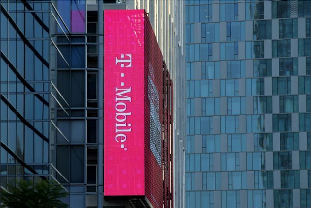 a t mobile logo is advertised on a building sign in los angeles california us on may 11 2017 photo reuters