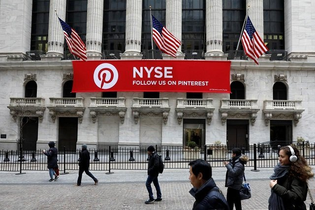 a pinterest banner hangs on the facade of the new york stock exchange nyse during the morning rush in the financial district in new york city us february 9 2018 photo reuters