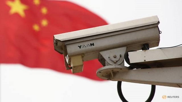 the chinese national flag flies near a security camera on beijing 039 s tiananmen square china may 19 2017 photo reuters