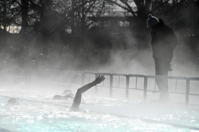 the arctic blast did not stop swimmers from diving into an outdoor pool in strasbourg photo afp