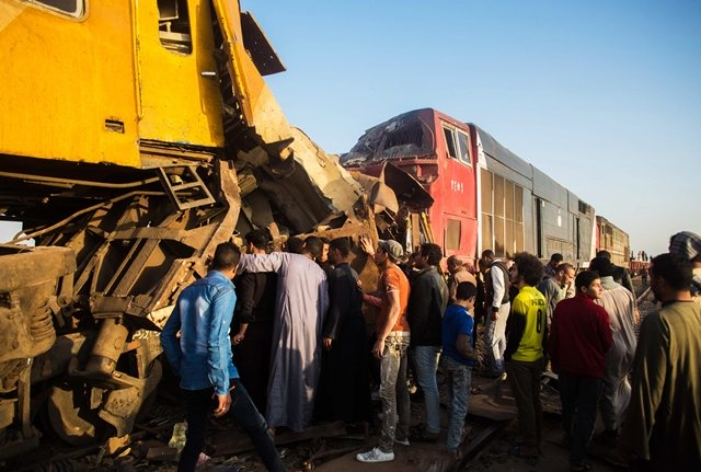 egyptians check the damage following a train crash in egypt 039 s northern beheira province on february 28 2018 at least 10 people were killed and 15 wounded when two trains collided in egypt the health ministry said photo afp