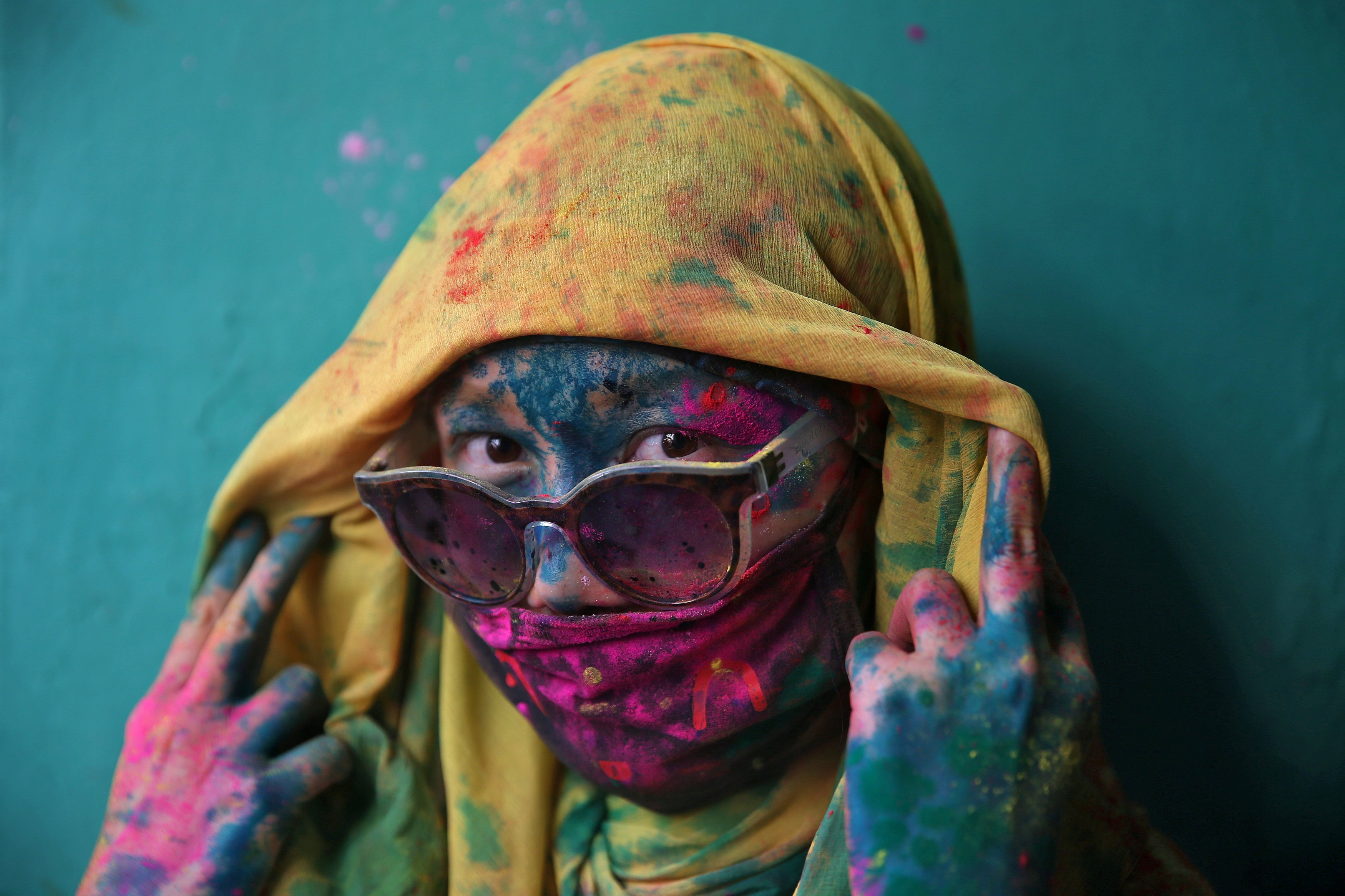 A woman poses for a photograph during Holi celebrations in the town of Barsana in the state of Uttar Pradesh. PHOTO: REUTERS