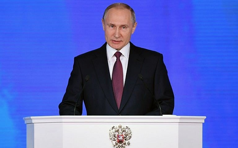 russian president vladimir putin addresses the federal assembly at moscow s manezh exhibition center photo afp