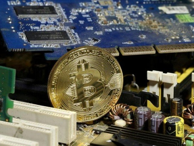 a copy of bitcoin standing on pc motherboard is seen in this illustration picture october 26 2017 photo reuters