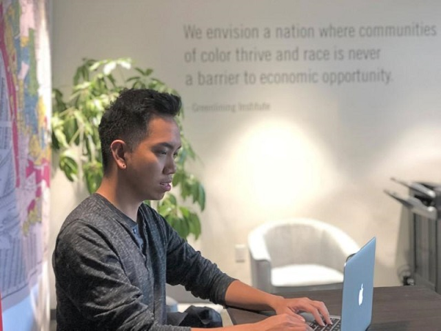 conrad contreras communications manager at greenlining institute an organization that advocates for racial justice works on a computer in oakland california us february 28 2018 photo reuters