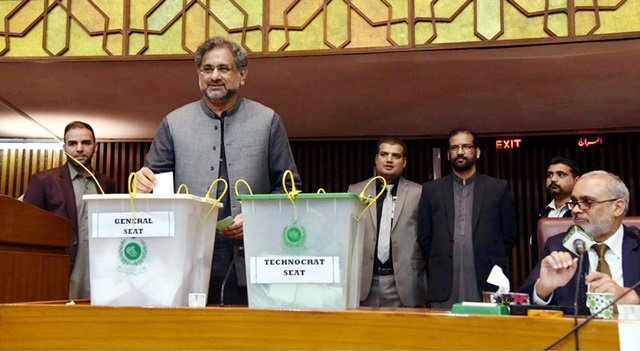 prime minister shahid khaqan abbasi casts his vote during senate election held at parliament house in islamabad on saturday photo ppi