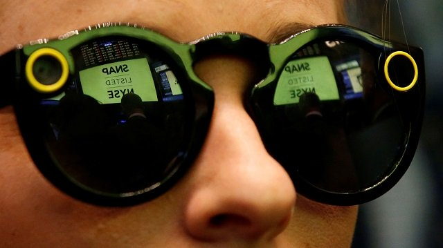 a woman wears snapchat spectacles on the floor of the new york stock exchange photo reuters