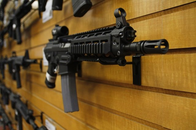 an automatic weapon is displayed photo reuters