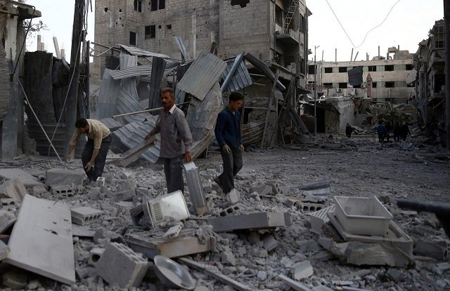 men inspect damages after an airstrike on the rebel held city of douma in the eastern damascus suburb of ghouta syria photo reuters