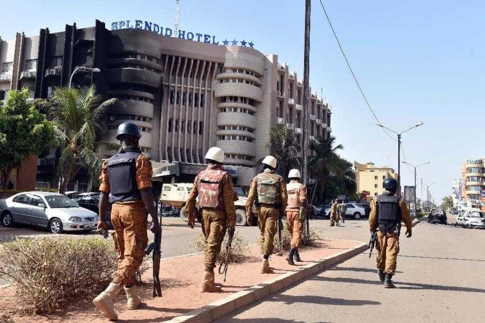 burkina faso troops patrol outside the splendid hotel and nearby cappuccino restaurant following a jihadist attack in ouagadougou on january 16 2016 photo afp
