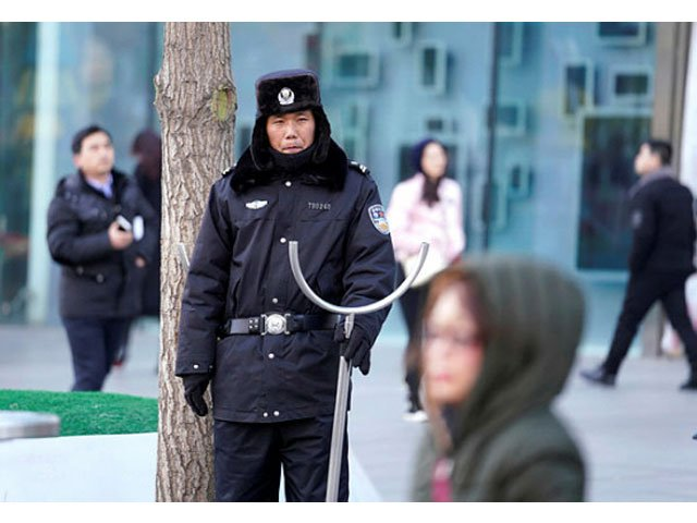 security personnel stand guard outside the joy city mall in the xidan district after a knife attack in beijing china feb 11 2018 photo reuters