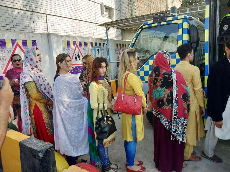 transgender persons line up in a queue waiting to process their driving licence documents in peshawar photo express