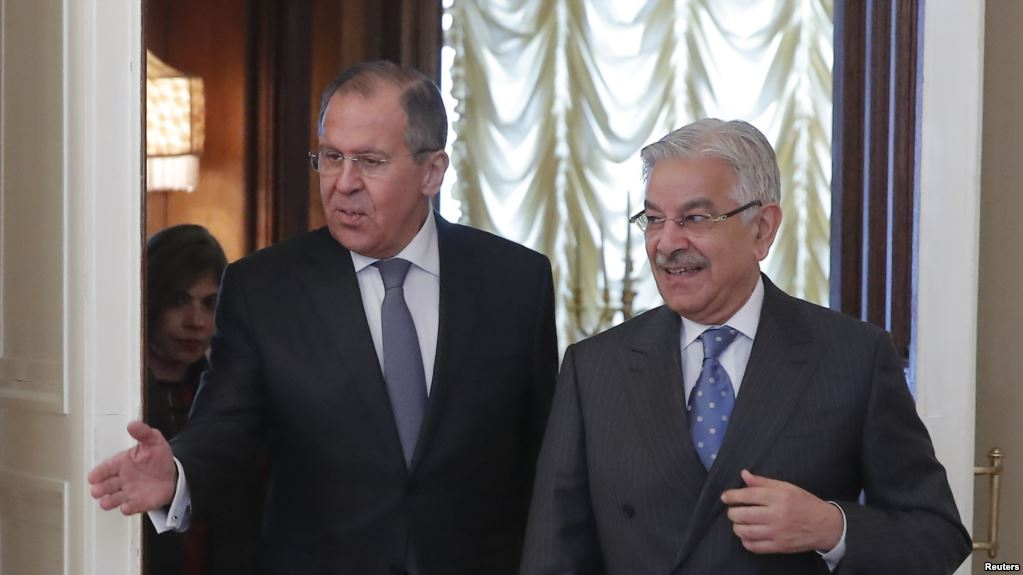 Russian Foreign Minister Sergei Lavrov shows the way to his Pakistani counterpart Khawaja Asif during a meeting in Moscow. PHOTO: REUTERS