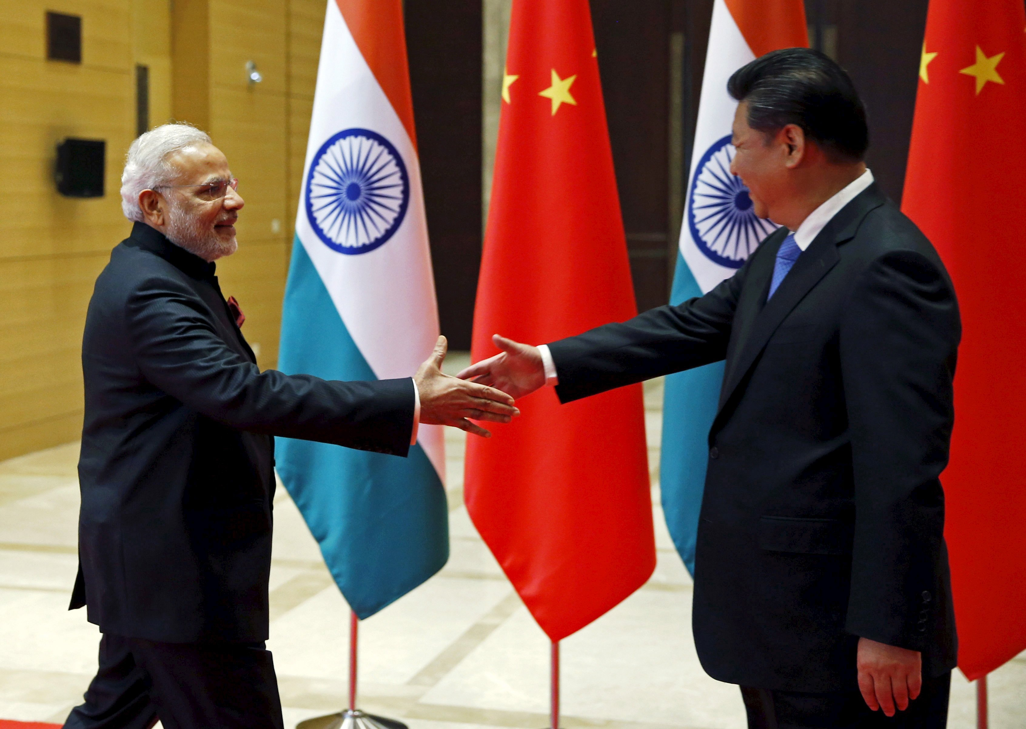 indian prime minister narendra modi and chinese president xi jinping shake hands before they hold a meeting in xian shaanxi province china photo reuters