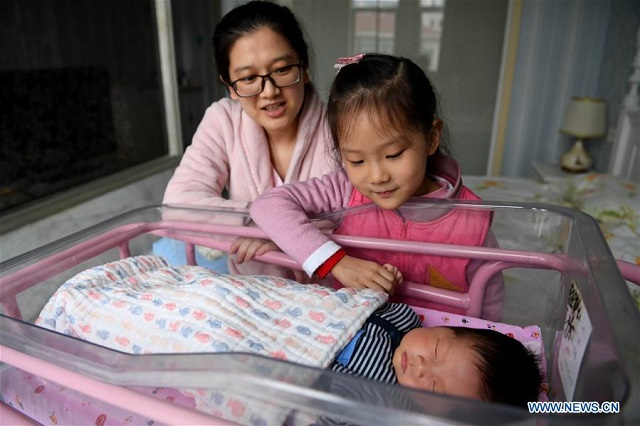 chinese moms think twice on second child photo xinhua