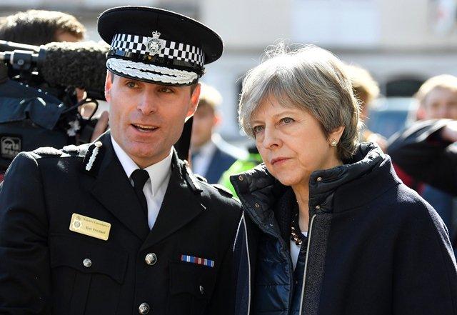 british pm urges global response in visit to spy attack scene