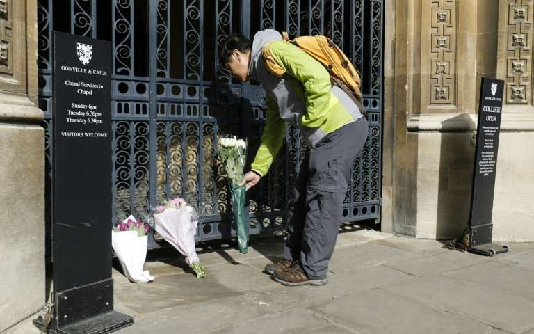 well wishers such as this man laying flowers outside gonville and caius college cambridge photo courtesy phys