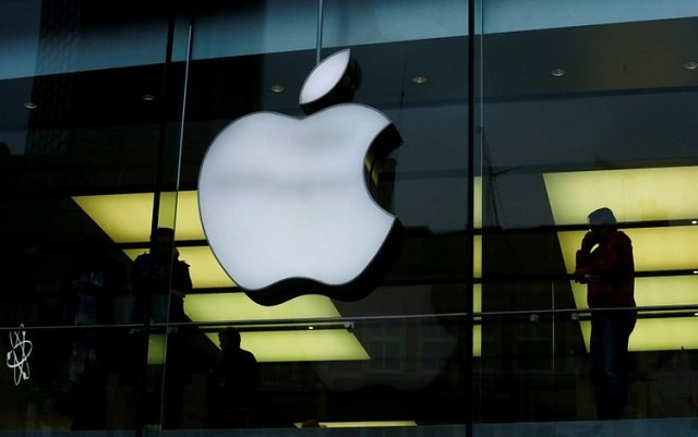 An Apple logo is seen on the building's facade as activists from the anti-globalisation organisation Attac hold the protest against alleged tax evasion by Apple company in front of an Apple store in Frankfurt, Germany, March 10, 2018.  PHOTO: REUTERS