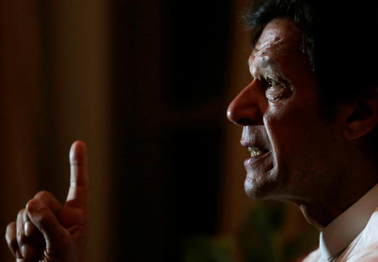 PTI chief Imran Khan speaks with Reuters correspondents at his home in Bani Gala, outside Islamabad. PHOTO: REUTERS