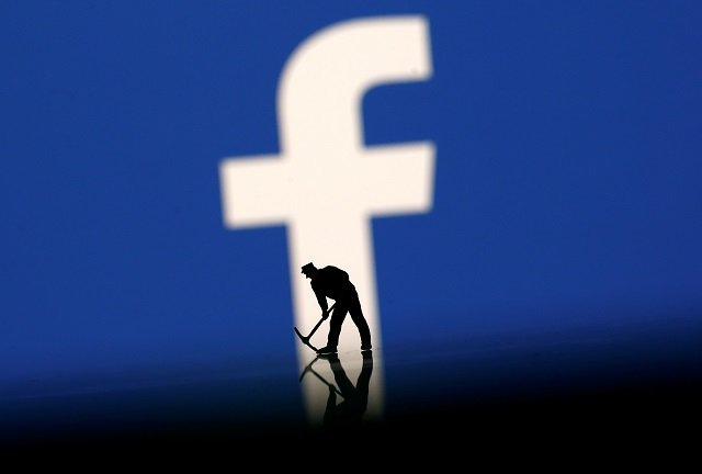 A figurine is seen in front of the Facebook logo in this illustration taken, March 20, 2018.  PHOTO: REUTERS