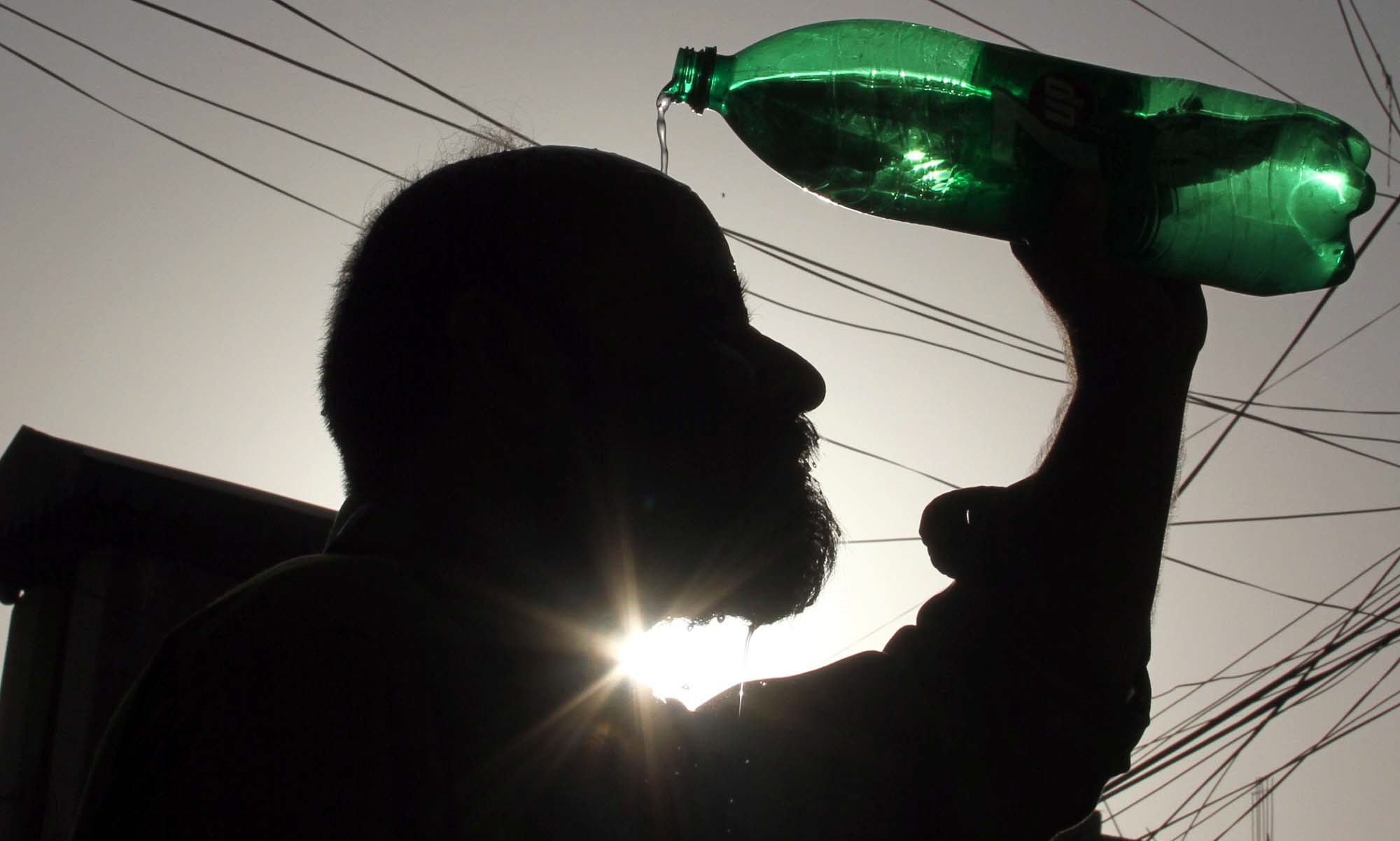 karachi swelters as k electric sscg trade blame
