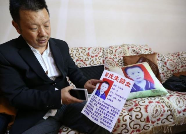 For years Wang Mingqing handed out leaflets appealing for information about his missing daughter. PHOTO COURTESY: BBC