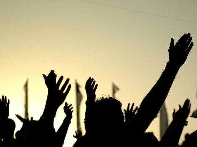 protesters block road in karimabad against police raid