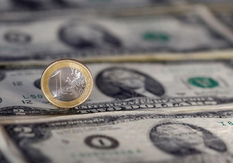 u s dollar note and a euro coin are seen in this picture illustration photo reuters