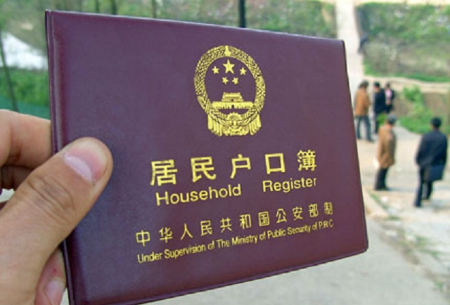 beijing launches point based hukou system