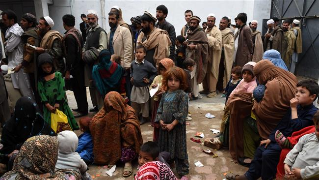 afghan refugees gather for renewal of their family cards at the chamkany registration center on the outskirts of peshawar photo afp