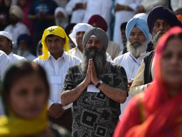 Sikh pilgrims gather in prayer at the Gurdwara Panja Sahib, one of Sikhism's most holy places. PHOTO: AFP