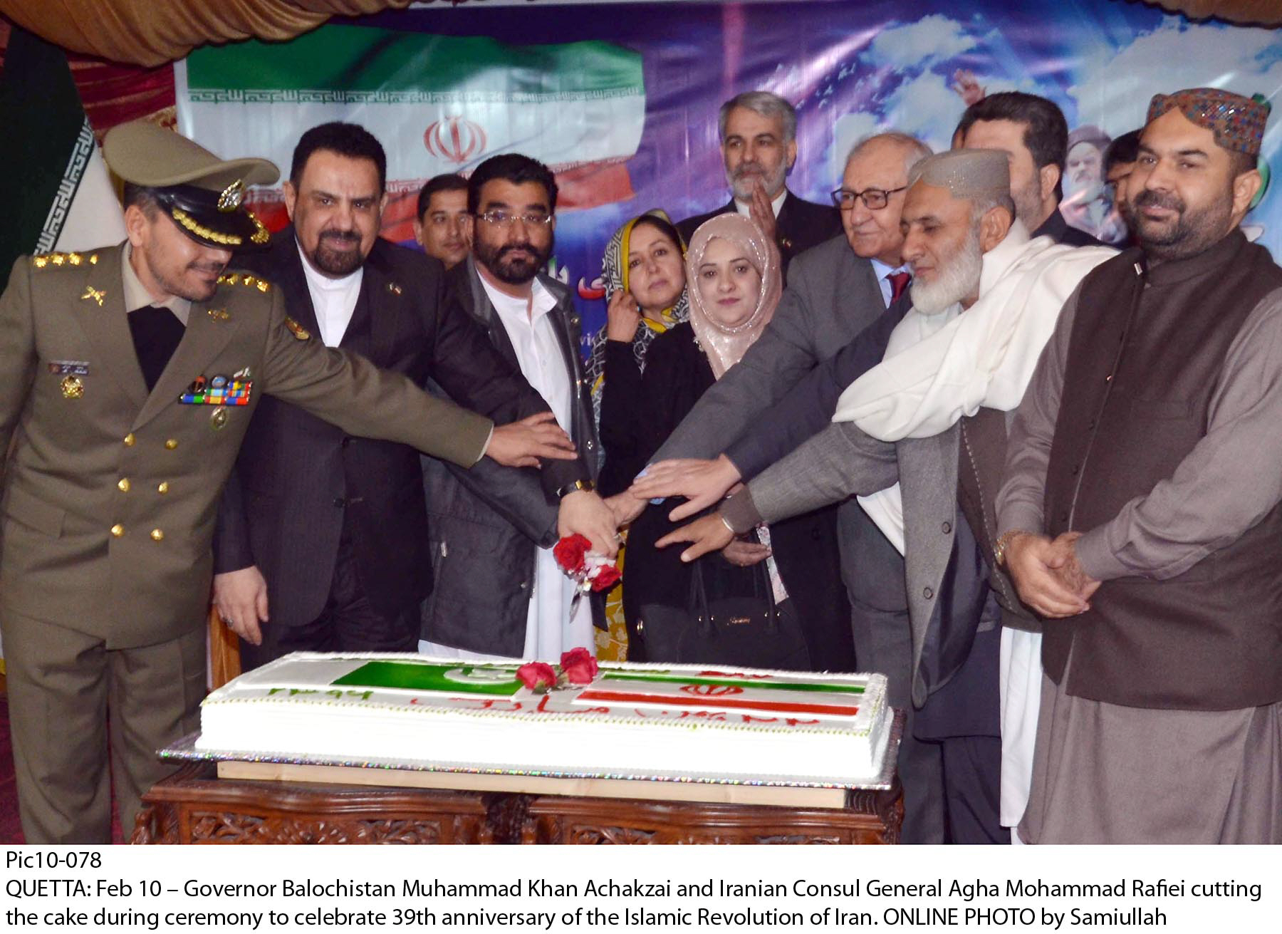 balochistan governor mohammad khan achakzai and iranian consul general agha mohammad rafiei along with others cut a cake during a ceremony to celebrate the 39th anniversary of the islamic revolution in iran photo online