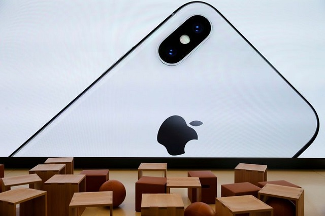 An iPhone X is seen on a large video screen in the Apple visitor centre in Cupertino, California, US, November 17, 2017. PHOTO: REUTERS