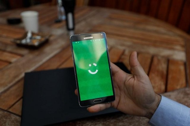 an employee shows the logo of ride hailing company careem on his mobile in his office in the west bank city of ramallah july 17 2017 photo reuters